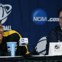Photo - West Virginia basketball coach Mike Carey laughs at center Asya Bussie's reaction to her cell phone ringing during a news conference prior to practice at the NCAA women's college basketball tournament in Baton Rouge, La., Monday, March 24, 2014. West Virginia faces LSU in the second-round game on Tuesday. (AP Photo/Rogelio V. Solis)