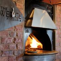Photo -  The Wedge Pizzeria, 4709 N Western, features pizzas baked in this wood-fired oven.  Photo by Dave Morris, NewsOK.com/The Oklahoman  Dave Morris