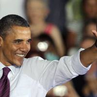 Photo -   President Obama waves to supporters during a grassroots campaign speech Friday, June 22, 2012, at Hillsborough Community College in Tampa, Fla. (AP Photo/Chris O'Meara)