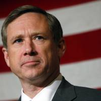 Photo -   FILE - In this Nov. 1, 2010 file photo, U.S. Sen. Mark Kirk, R-Ill., looks to a crowd of supporters during a campaign rally in Wheaton, Ill. Kirk is climbing the 103 floors of the Willis Tower months after suffering a major stroke. Officials with