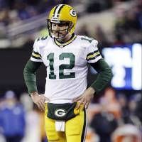 Photo - Green Bay Packers quarterback Aaron Rodgers (12) reacts during the first half of an NFL football game against the New York Giants, Sunday, Nov. 25, 2012, in East Rutherford, N.J. (AP Photo/Kathy Willens)