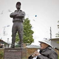 Photo - Ray Ackerman admires the statue put up in his honor for the work he put in on the Oklahoma River during the statue dedication of Ray Ackerman near the Chesapeake Boathouse on Friday, April 20, 2012, in Oklahoma City, Oklahoma.  Photo by Chris Landsberger, The Oklahoman