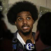 Photo - FILE - In this March 1, 2013 file photo, Philadelphia 76ers' Andrew Bynum speaks to members of the media at the team's NBA training facility in Philadelphia. A person familiar with the visit says the Cleveland Cavaliers are hosting free agent center Andrew Bynum.  The 7-foot Bynum, who didn't play one game for Philadelphia last season because of a knee injury, is meeting with team officials Monday, July 8, 2013, said the person who spoke on condition of anonymity because of the sensitivity of negotiations.  (AP Photo/Matt Rourke, File)