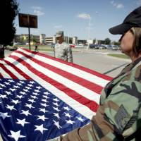 Photo - U.S. / UNITED STATES / AMERICA / AMERICAN / FLAG FOLDING: Tech. Sgt. Amy Odom, right,  and Senior Airman Molly Wittry fold the flag, Thursday, June 4, 2009, at Tinker Air Force Base in Midwest City, Okla. Photo by Sarah Phipps, The Oklahoman ORG XMIT: KOD