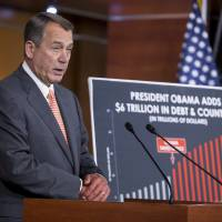 Photo - Speaker of the House John Boehner, R-Ohio, speaks with reporters about the looming deadline to fund the government and the fight among House Republicans on a strategy,  on Capitol Hill in Washington, Thursday, Sept. 19, 2013. House Republicans vowed Wednesday to pass legislation that would prevent a partial government shutdown and avoid a historic national default while simultaneously canceling out President Barack Obama's health care overhaul, inaugurating a new round of political brinkmanship as critical deadlines approach. (AP Photo/J. Scott Applewhite)