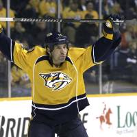 Photo - FILE - In this Jan. 12, 2014 file photo, Nashville Predators center David Legwand warms up to play  against the Minnesota Wild in an NHL hockey game in Nashville, Tenn. The Nashville Predators announced Wednesday, Feb. 5, 2014 that they have traded away their first draft pick, sending forward David Legwand back to his hometown Detroit. The Predators got Patrick Eaves, a prospect and a third-round draft pick in exchange for Legwand. (AP Photo/Mark Humphrey, File)