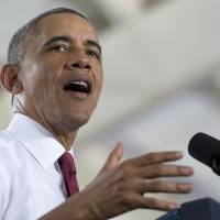 Photo - President Barack Obama speaks about the economy, jobs, and manufacturing, Wednesday, Jan. 15, 2014, at North Carolina State University in Raleigh, N.C. (AP Photo/Carolyn Kaster)