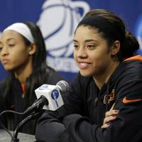Photo - Oklahoma State guard Brittney Martin, right, listens to a question as guard Tiffany Bias sits near during an NCAA college basketball tournament news conference in West Lafayette, Ind., Sunday, March 23, 2014. Oklahoma State faces Purdue in a second round game on Monday. (AP Photo/Michael Conroy)