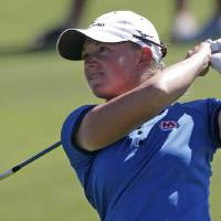 Photo -   Stacy Lewis watches her approach shot to the 10th green during final round play in the Navistar LPGA Classic golf tournament, Sunday, Sept. 23, 2012, at the Robert Trent Jones Golf Trail in Prattville, Ala. (AP Photo/Dave Martin)