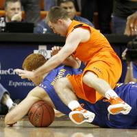 Photo - OKLAHOMA STATE UNIVERSITY: Oklahoma's Keiton Page (12) goes for the ball behind Tulsa's David Wishon (15) during an NCAA men's college basketball game between the Oklahoma State Cowboys (OSU) and the Tulsa Golden Hurricane (TU), at Gallagher-Iba Arena in Stillwater, Okla., Wednesday, Nov. 30, 2011. Photo by Bryan Terry, The Oklahoman