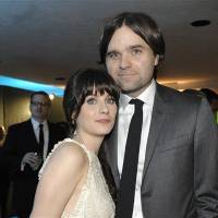 Photo - FILE - In this Jan. 16, 2011 file photo, actress Zooey Deschanel, left, and her husband, singer Ben Gibbard attend the 2011 HBO Golden Globe Party in Beverly Hills, Calif. Court records show a Los Angeles judge finalized the former couple's divorce on Wednesday Dec. 12, 2012. The pair were married in 2009 and separated in October 2011. (AP Photo/Dan Steinberg, file)