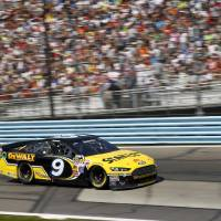 Photo - Marcos Ambrose (9) drives during a NASCAR Sprint Cup Series auto race at Watkins Glen International, Sunday, Aug. 10, 2014, in Watkins Glen N.Y. (AP Photo/Mel Evans)