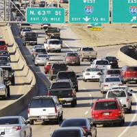 Photo - Above left: Traffic travels north on Interstate 235 at Interstate 44 during rush hour Wednesday in Oklahoma City.  PHOTO BY DOUG HOKE,  THE OKLAHOMAN
