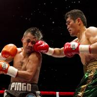Photo -  Brian Viloria, of Waipahu, Hawaii, right, lands a punch against WBO flyweight title holder Julio Cesar Miranda, of Mexico, in the 3rd round,  Saturday, July 16, 2011, in Honolulu.  Viloria defeated Miranda after 12 rounds.  (AP Photo/Marco Garcia)