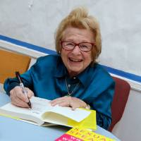 Photo -   In this Thursday, April 26, 2012 photo, Dr. Ruth Westheimer signs a copy of her book at the National Council of Jewish Women in New York. In 1980, Westheimer broke into late-night radio with