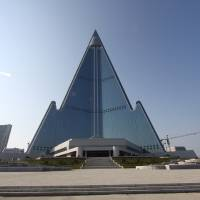 Photo -   In this Sept. 23, 2012 photo released by Koryo Group on Wednesday, Sept. 26, 2012, the pyramid-shaped, 105-story Ryugyong Hotel stands in Pyongyang, North Korea. A foreign tour agency said the interior of the massive, hotel in the North Korea capital remains unfinished. Beijing-based Koryo Tours got a sneak peek inside the hotel that has been an off-limits construction site and remains a source of fascination for the outside world. (AP Photo/Koryo Group) NO SALES EDITORIAL USE ONLY