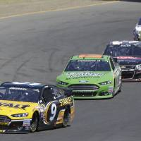 Photo - Marcos Ambrose (9), of Australia, leads Ricky Stenhouse Jr., Austin Dillon, Clint Bowyer, Tony Stewart and Kasey Kahne during the NASCAR Sprint Cup Series auto race Sunday, June 22, 2014, in Sonoma, Calif. (AP Photo/Eric Risberg)