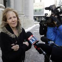 Photo - Former polygamist Kristyn Decker speaks with reporters before a hearing on whether Utah can prohibit plural marriage, Thursday, Jan. 17, 2013, in Salt Lake City. (AP Photo/Rick Bowmer)