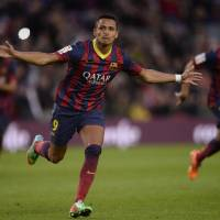 Photo - FC Barcelona's Alexis Sanchez, from Chile, reacts after scoring against Elche during a Spanish La Liga soccer match at the Camp Nou stadium in Barcelona, Spain, Sunday, Jan 5, 2014. (AP Photo/Manu Fernandez)