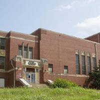 Photo - Page Woodson Elementary School sits abandoned on at the corner of NE 6 and N High Avenue.  Chris James - The Oklahoman