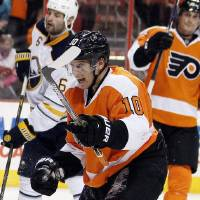 Photo - Philadelphia Flyers' Brayden Schenn reacts after scoring during the second period of an NHL hockey game against the Buffalo Sabres, Sunday, April 6, 2014, in Philadelphia. (AP Photo/Tom Mihalek)