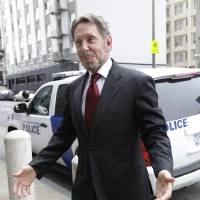 Photo -   Oracle CEO Larry Ellison arrives for a court appearance at a federal building in San Francisco, Tuesday, April 17, 2012. Oracle intends to rely heavily on Google's own internal emails to prove Google's top executives knew they were stealing a popular piece of technology to build the Android software that now powers more than 300 million smartphones and tablet computers. (AP Photo/Paul Sakuma)