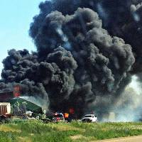 Photo - Smoke rises from two freight trains that collided June 24 near Goodwell. The National Transportation Safety Board said Monday the trains weren't speeding at the time of the wreck. Archive Photo By Trudy Hart, The Guymon Daily Herald/AP