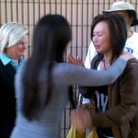 Photo - FILE - In this May 22, 2012 file photo Bei Bei Shuai, 35, right, Indianapolis, hugs her friend, Sue Mak, second left, as attorney Linda Pence, left, looks on after Shuai's release on bail from the Marion County Jail in Indianapolis. Prosecutors who charged Shuai with murdering her infant because she ate rat poison while pregnant are asking an Indiana judge to take steps during the trial that critics say are meant to stifle any sympathy jurors might have for a woman who's become an international cause. (AP Photo/Charles D. Wilson, File)