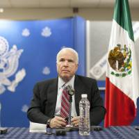 Photo - Republican Sen. John McCain, from Arizona, pauses during a press conference in Mexico City, Friday, Feb. 22, 2013. McCain says he is guardedly optimistic about producing an immigration reform proposal that includes a path to legalization for illegal immigrants but significant disagreement remains between President Obama and a group of lawmakers drafting a bill. (AP Photo/Alexandre Meneghini)