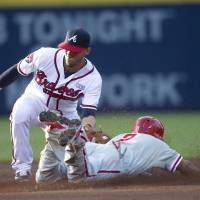 Photo - Philadelphia Phillies' Ben Revere (2) steals second base as Atlanta Braves shortstop Andrelton Simmons (19) applies the late tag in the first inning of a baseball game Tuesday, Sept. 2, 2014, in Atlanta. (AP Photo/John Bazemore)
