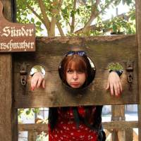 Photo - The pillory, with holes for head and hands, forced the accused to stand uncomfortably. Today, it's a popular prop for tourist photos. (Photo credit: Laura VanDeventer)