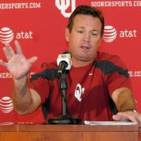 Photo - Oklahoma coach  Bob  Stoops speaks during his weekly news conference Tuesday, Sept. 14, 2010, in Norman, Okla.  Stoops  said that he agreed with Oklahoma's administration that the national anthem should be sung correctly at Sooner football games. Some fans are ending the anthem with