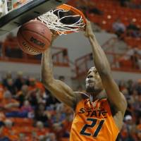 Photo - Oklahoma State forward Kamari Murphy dunks against Central Arkansas in the first half of an NCAA college basketball game in Stillwater, Okla., Sunday, Dec. 16, 2012. Oklahoma State won 91-63. (AP Photo/Sue Ogrocki) ORG XMIT: OKSO110