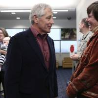 Photo - U.S. Secretary of Defense Chuck Hagel talks with retired Army Col. Rebecca Hooper, program manager for the Center for the Intrepid, after Hagel spoke to soldiers, veterans and staff at the center in San Antonio on Wednesday, Jan. 8, 2014. (AP Photo/The San Antonio Express-News, Lisa Krantz)  RUMBO DE SAN ANTONIO OUT; NO SALES