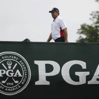 Photo - Kenny Perry walks on the bridge to the first tee during the final round of the PGA Championship golf tournament at Valhalla Golf Club on Sunday, Aug. 10, 2014, in Louisville, Ky. (AP Photo/Mike Groll)