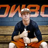Photo - Oklahoma State freshman infielder Donnie Walton poses for a photo before the team leaves for its regional in Louisville on Tuesday, May 28, 2013 in Stillwater, Okla.  Photo by Chris Landsberger, The Oklahoman