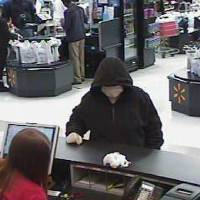 Photo - Oklahoma City police and the FBI are investigating a reported robbery at an Arvest Bank branch located inside Walmart at 7800 Northwest Expressway in Oklahoma City.