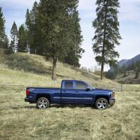 Photo - This undated handout photo  made available by General Motors shows the 2014 Chevrolet Silverado. General Motors unveiled a new versions of its top-selling Chevrolet Silverado and GMC Sierra on Thursday Dec. 13, 2012. The 2014 models will go on sale by early spring or late summer. The models roll into a market where truck sales are growing after a five-year slump.  (AP Photo/General Motors)