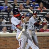 Photo - Washington Nationals' Michael A. Taylor hits a two-run home run during the sixth inning of a baseball game against the New York Mets Tuesday, Aug.12, 2014, at Citi Field in New York. It was Taylor's first career major league home run. (AP Photo/Bill Kostroun)