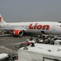 Photo - FILE- A Lion Air passenger jet plane is parked on the tarmac at Juanda International Airport in Surabaya, Indonesia, in this file photo dated May 12, 2012.    Indonesian airline Lion Air is to buy 234 short to medium range aircraft from Airbus it is announced Monday March 18, 2013, for euro 18.4 billion (US dlrs24 billion), in what is being billed as the biggest civilian deal in the history of the aircraft manufacturer. The contract was announced Monday at the French presidential palace, a sign of the deal's importance to the French government, and helping to secure around 5,000 jobs at a time when French unemployment hovers over 10 percent. (AP Photo/Trisnadi, File)