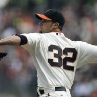 Photo - San Francisco Giants' Ryan Vogelsong works against the Cleveland Indians in the first inning of a baseball game, Sunday, April 27, 2014, in San Francisco. (AP Photo/Ben Margot)