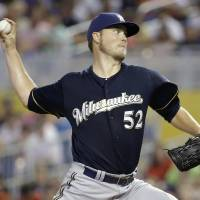 Photo - Milwaukee Brewers starting pitcher Jimmy Nelson throws in the first inning during a baseball game against the Miami Marlins, Sunday, May 25, 2014, in Miami. (AP Photo/Lynne Sladky)