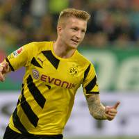 Photo - Dortmund's Marco Reus celebrates after scoring during the  soccer match between FC Augsburg and Borussia Dortmund in the SLG Arena in Augsburg, Germany, on Friday, Aug. 29, 2014. (AP Photo/Kerstin Joensson)