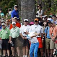Photo - Jonas Blixt, of Sweden, hits out of the rough off the second fairway during the fourth round of the Masters golf tournament Sunday, April 13, 2014, in Augusta, Ga. (AP Photo/Matt Slocum)