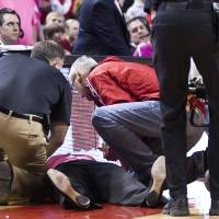 Photo - Nebraska head coach Connie Yori is tended to after collapsing on the court during the NCAA women's college basketball game between Nebraska and Indiana at the Pinnacle Bank Arena, Sunday, Feb. 16, 2014, in Lincoln, Neb. She was hospitalized after collapsing. Associate athletic director Marc Boehm said Yori had been bothered by dizzy spells before the end of the game. (AP Photo/The Journal-Star, Morgan Spiehs) LOCAL TV OUT; KOLN-TV OUT; KGIN-TV OUT; KLKN-TV OUT.