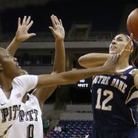 Photo - Notre Dame's Taya Reimer (12) shoots over Pittsburgh's Loliya Briggs (1) and another defender during the first half of an NCAA college basketball game Thursday, Jan. 16, 2014, in Pittsburgh. (AP Photo/Keith Srakocic)
