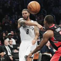 Photo -   Brooklyn Nets' Deron Williams (8) passes away from Toronto Raptors' Kyle Lowry (3) during the first half of an NBA basketball game, Saturday, Nov. 3, 2012, in New York. (AP Photo/Frank Franklin II)