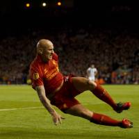 Photo -   Liverpool's Jonjo Shelvey celebrates after scoring against Udinese, during their Europa League Group A soccer match at Anfield Stadium, Liverpool, England, Thursday Oct. 4, 2012. (AP Photo/Jon Super)