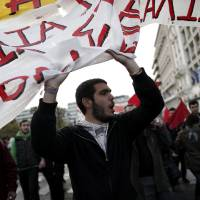 Photo -   Protesters chant slogans during a rally in Athens on Saturday, Nov. 17, 2012. Several thousand marchers are commemorating the 39th anniversary of a deadly student uprising against the then ruling dictatorship, with more than 6,000 police deployed in the center of the Greek capital.(AP Photo/Petros Giannakouris)