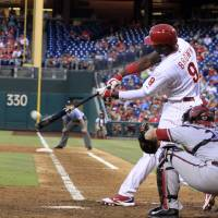 Photo - Philadelphia Phillies' Domonic Brown (9) hits a double against the Arizona Diamondbacks in the third inning of a baseball game on Friday, July 25, 2014, in Philadelphia. (AP Photo/H. Rumph Jr)
